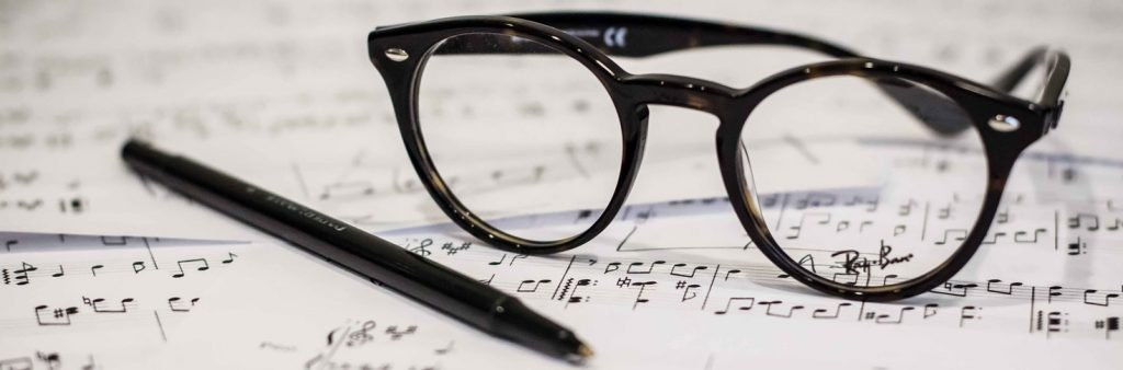 glasses on music score Brand Symphony Marketing