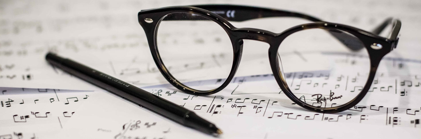 glasses on music score Brand Symphony Marketing