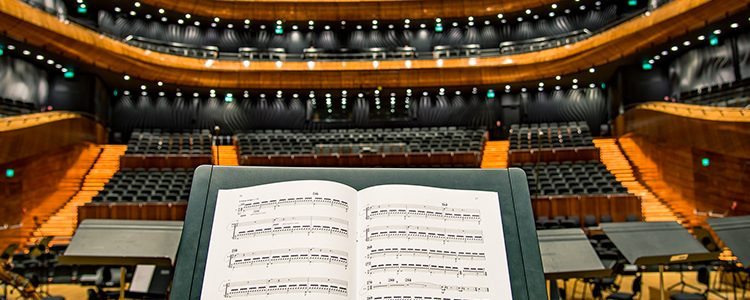 Empty concert hall and CMO music stand Brand Symphony Marketing