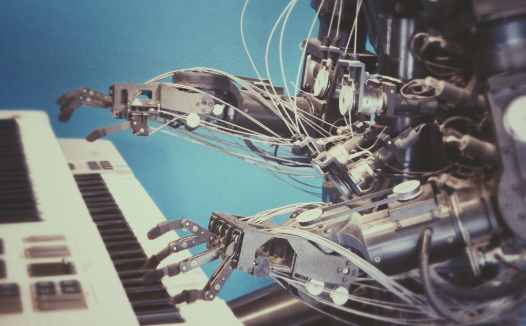 robot on piano SaaS brand symphony blog